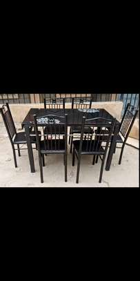 Good Price dining table with 6 chairs image 1