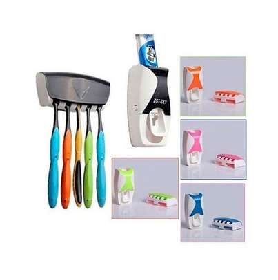 Coloured toothpaste dispenser with toothbrush holding rack image 1