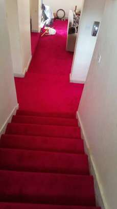RED CARPETING ON YOUR STAIR CASES image 3