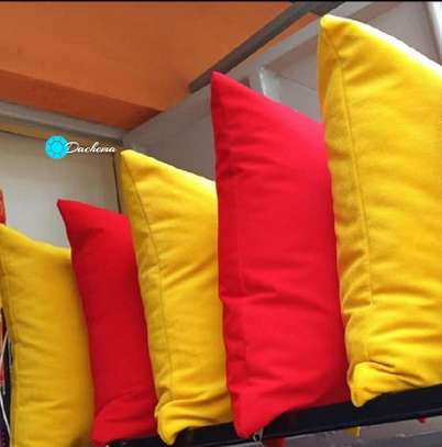 red and yellow throw pillows image 1