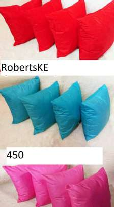 red, blue and pink pillows image 1