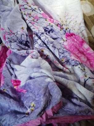 Fleece blankets and warmers image 7