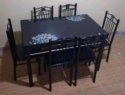 6 seater Dining table and chairs of which are slightly curved back for maximum comfort while enjoying meals image 1