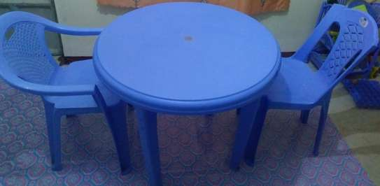 Round plastic table with two chairs