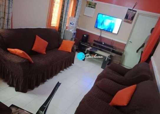 5 seater brown elastic sofa covers image 1