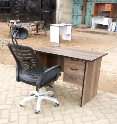 An office table with movable adjustable high-back chair image 1
