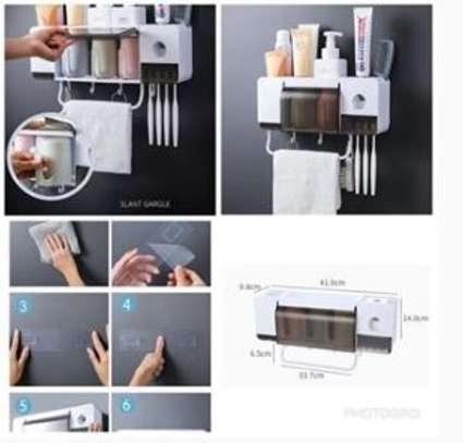 Multifunctional dustproof Toothpatse dispenser/wall organizer and towel holder image 1