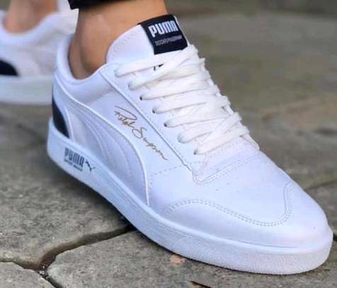Ladies White Puma sneakers image 1