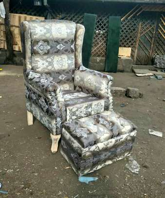 Wing back seat and ottoman