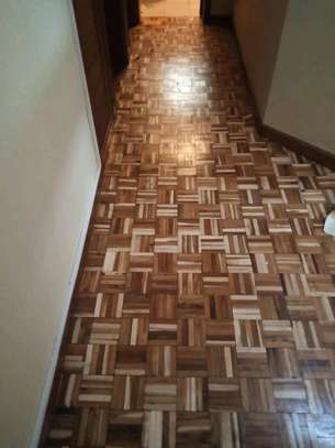 Wooden floor installation sanding and polishing services. image 8