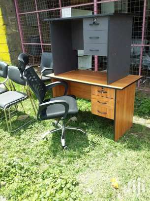 An office chair in black and a desk H54W image 1