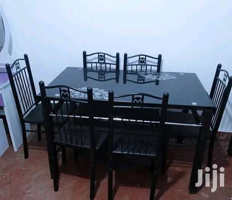 Industrial glass dining table with chairs image 1