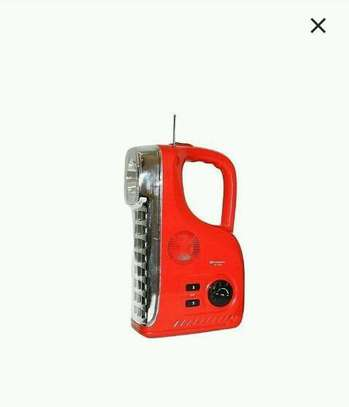 Emergency rechargeable light with radio