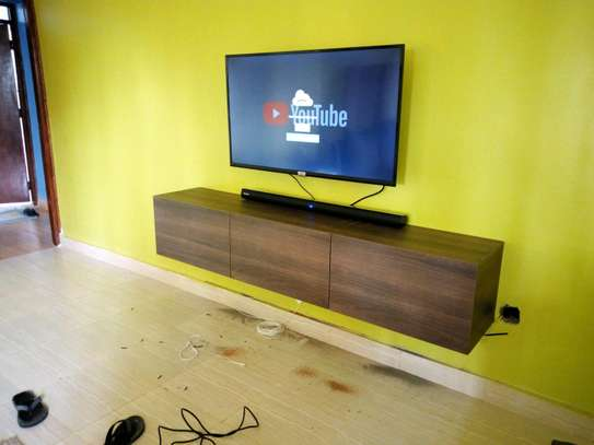 Functional floating TV stand