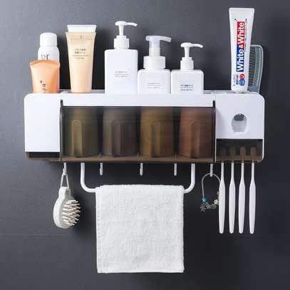 Toothpaste holder and bathroom organizer image 1
