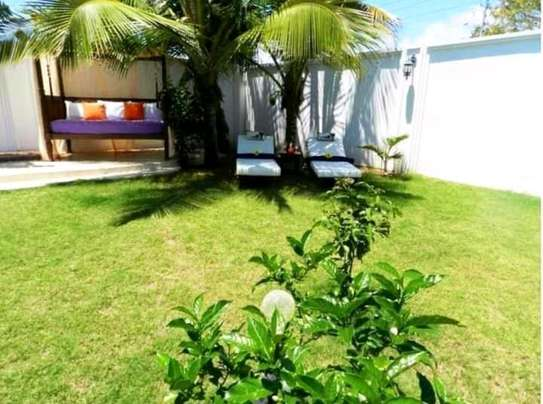 3 bedroom fully furnished own compound image 8