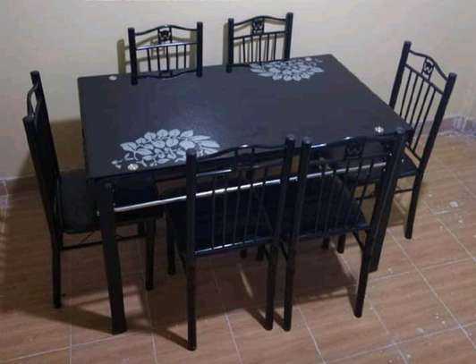 Dining table with black chairs image 1