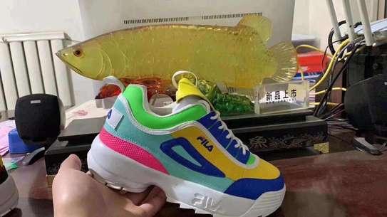 Multiple colored fila shoes image 1