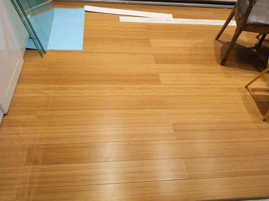Wooden floor installation sanding and polishing services. image 4