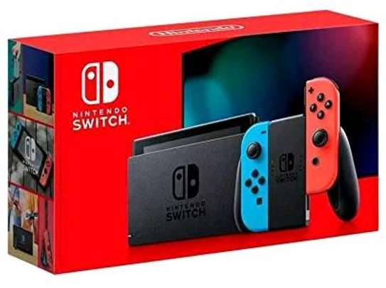 Nintendo Switch with neon red and neon blue Joy‑Con - Version 2-HAC-001(-01) image 1