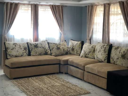 7 seater couch with storage Ottomsn