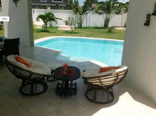3 bedroom fully furnished own compound image 5