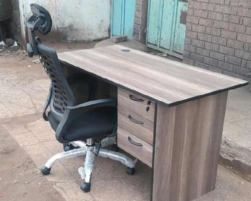 An office desk with height adjustable mechanism chair image 1