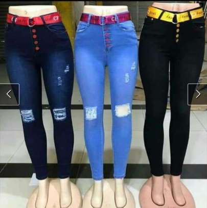 Women knee ripped jeans image 1