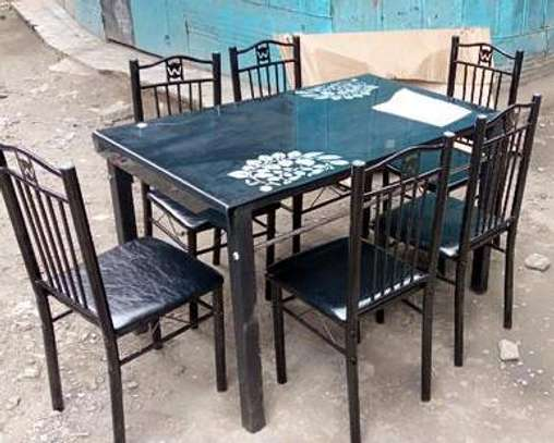 6 seater Dining table with adjustable leg pad image 1