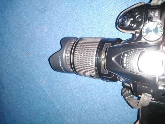 Nikon d5300 with speedlight and two batteries image 2