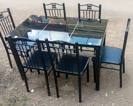 Home dining table with chairs of which has leather covering d image 1
