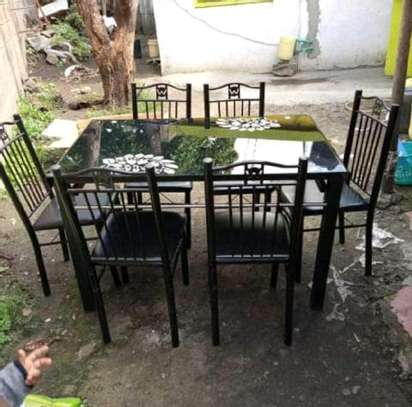 Dining table and chairs of single wipe while cleaning image 1