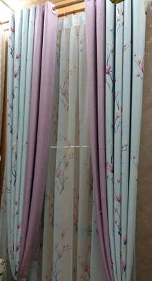 Floral curtain with purple detail