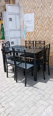 Steel supporting frame dining table with 6 chairs set image 1