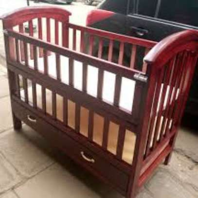 Selling baby cots image 1
