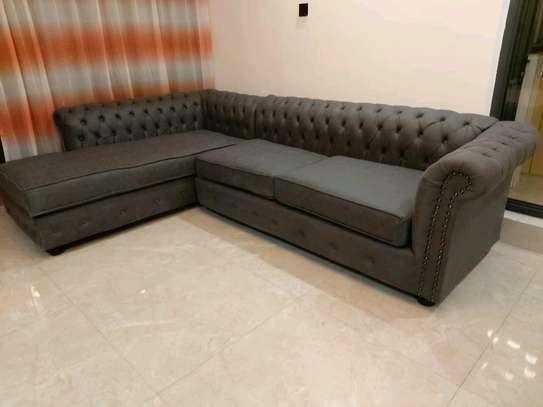 L shaped tufted sofa image 1