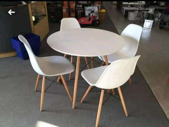 Round Eames tables and chairs image 1