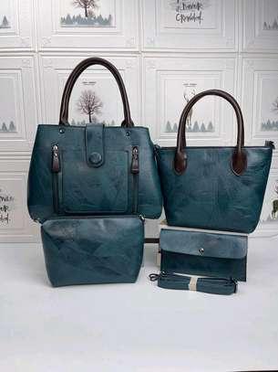 Blue-green leather handbags image 1