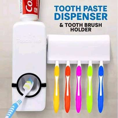 Toothpaste dispenser and toothbrush holder image 1