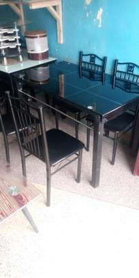 Quality four seater dining table comes with chairs image 1