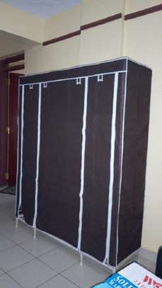dark brown three column wooden wardrobe image 1