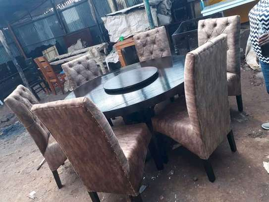 6 seater dining table with a bearing image 1