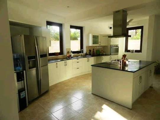 3 bedroom fully furnished own compound image 14