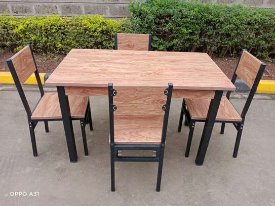 Wooden dining table image 1