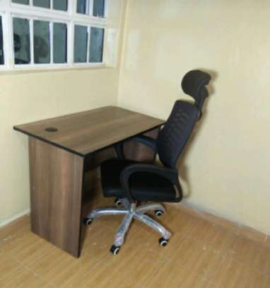 An office desk with high-back manager office chair image 1