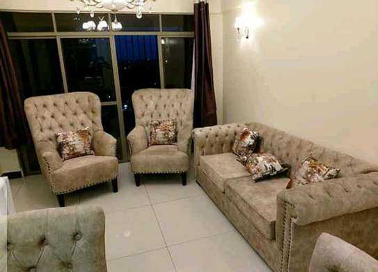 Tufted sofa and wing back chairs image 1