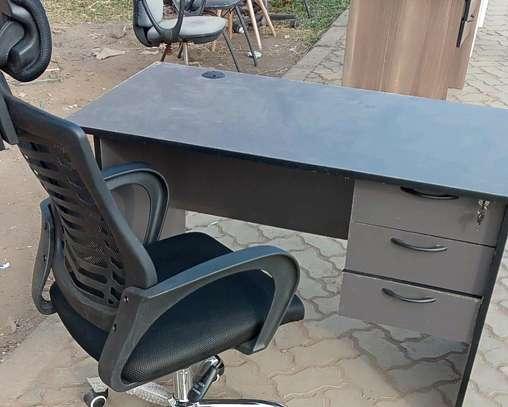Adjustable headrest office chair plus an office desk