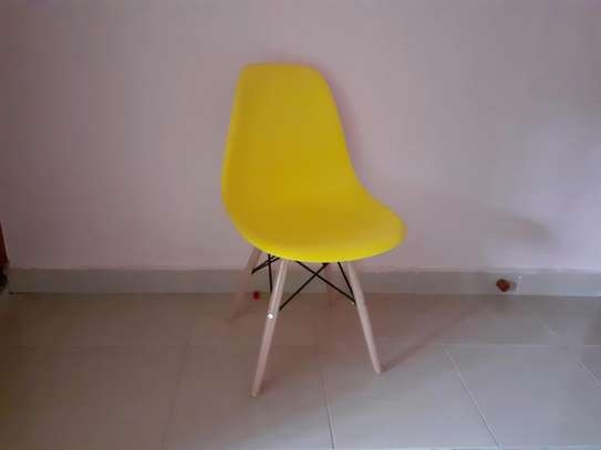Yellow eames chair image 1