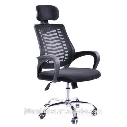 An adjustable headrest office chair with reclining back image 1