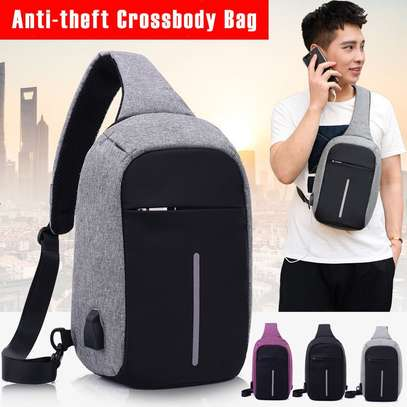 Anti-theft cross body backpack (single strap) with a USB charging port. image 3